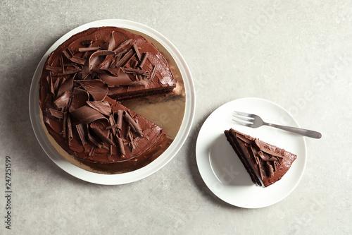 Leinwandbild Motiv Flat lay composition with tasty chocolate cake on table