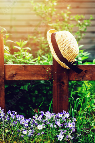 gardener hat on wooden fence in summer garden