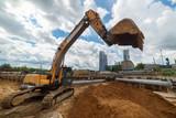 Tracked excavator with raised bucket. Modern earthmoving equipment - 247293181