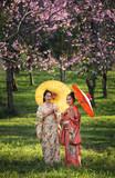 Asian woman wearing traditional japanese kimono with sakura