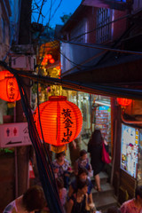 Beautiful red lantern of Old Town Jiufen with crowd of tourists sightseeing at nighttime in New Taipei City, Taiwan