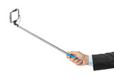 Hand and smartphone with selfie stick - 247296367