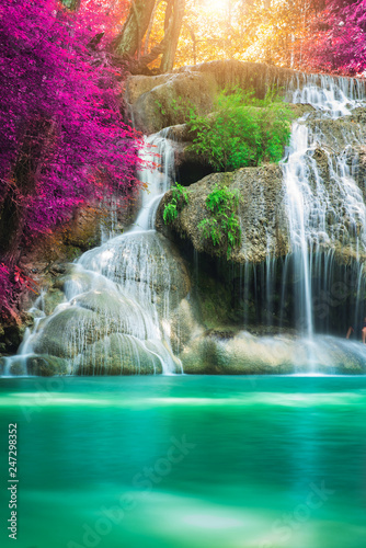 Amazing in nature, beautiful waterfall at colorful autumn forest in fall season  - 247298352