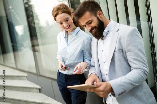 Leinwandbild Motiv Picture of handsome businessman and attractive businesswoman