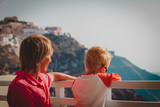 father and little son looking at caldera in Santorini, Greece - 247303740
