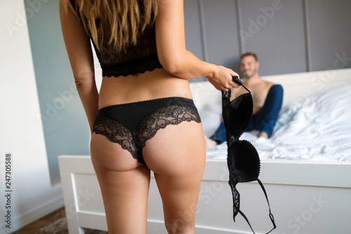 Leinwanddruck Bild Sexy woman getting ready for sex in bedroom