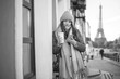Girl in a coat in Paris.