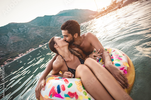 Leinwanddruck Bild Happy couple resting at sea resort