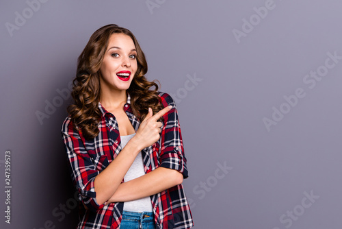 Leinwandbild Motiv Portrait of nice-looking cute attractive lovely charming pretty cheerful cheery glad ecstatic wavy-haired lady pointing aside presentation isolated over gray pastel purple background