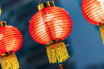 beautiful translucent red chinese lanterns against sunlight, shallow depth of field