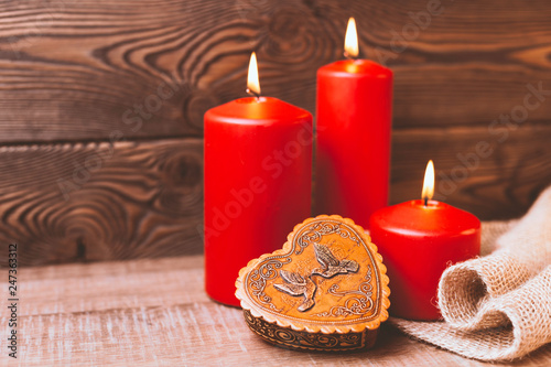 Valentine background. Red candles, a box in the form of a heart in rustic style . Selective focus. Copy space © Ирина Селина