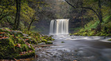 Beautiful waterfall cascading into teh riverbed located in south wales.