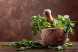 Bunch of fresh green organic mint in mortar. - 247373387