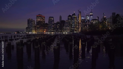 Urban Cityscape of Lower Manhattan and River with Piers at Night. New York City, United States of America