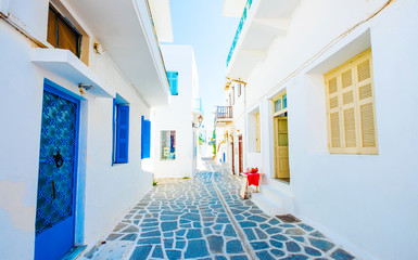 Beautiful view of white buildings along stony greek street