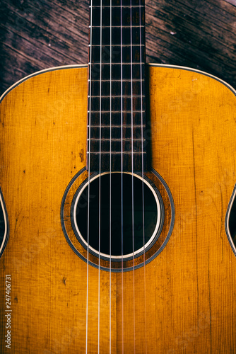 Closeup of wooden acoustic guitar from above. - 247406731