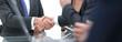 Leinwandbild Motiv close-up of business handshake.panoramic photo