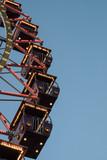Ferris wheel in the evening lighting - 247424519
