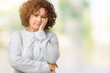 Beautiful middle ager senior woman wearing winter sweater over isolated background thinking looking tired and bored with depression problems with crossed arms.