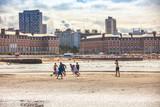 Mar Del Plata, Argentina - 26 Octubre, 2018: Children playing football on the shores of the Atlantic Ocean