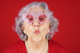 Comical granny with heart shape glasses