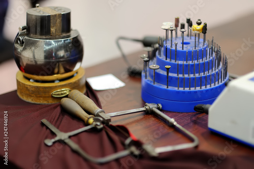 Close up jeweler tools on table. © Maria Sbytova