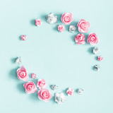 Flowers composition. Wreath made of rose flowers on pastel blue background. Valentines day, mothers day, womens day, spring concept. Flat lay, top view, copy space, square