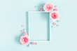 Leinwanddruck Bild - Flowers composition. Photo frame, rose flowers on pastel blue background. Valentines day, mothers day, womens day, spring concept. Flat lay, top view, copy space