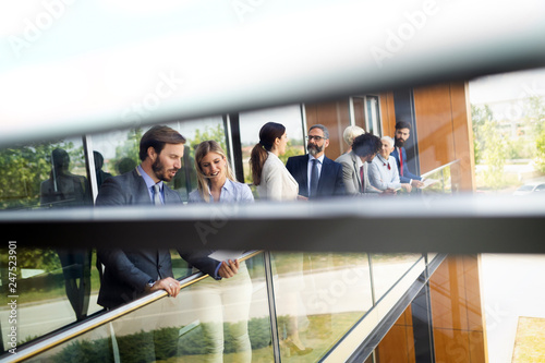 Leinwandbild Motiv Businesspeople talking on break outdoor about business plans