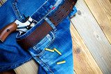 fashion old blue jeans and vintage revolver - 247528187