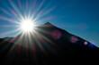 Star sun behind high Teide volcano in Tenerife