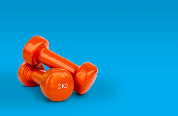 Orange Dumbbell Weights © Konstantinos Moraiti