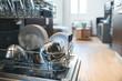 Leinwanddruck Bild - open dishwasher with clean dishes at home kitchen