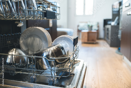 Leinwanddruck Bild open dishwasher with clean dishes at home kitchen