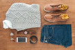 Flat lay with male clothes, shoes and accessories on wooden background