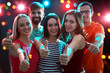Leinwandbild Motiv People showing OK sign in the night club