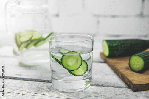 glass with cucumber water on the table