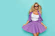 Beautiful Smiling Blond Woman In Sunglasses And Purple Costume