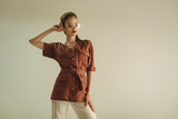 attractive fashionable woman in vintage clothing posing isolated on beige - 247576988