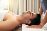 Man relaxing in wellness center - 247579987