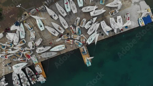 Sailors preparing for the regatta in Hvar Croatia. laser and optimist sailing class on the shore. view from above on sailing boats