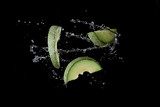 Japanese melon green with water splash or explosion flying in the air isolated on black background