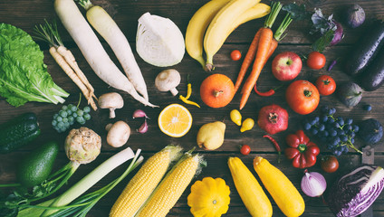 White, yellow, green, orange, red, purple fruits and vegetables on wooden background.  Healthy food. Multicolored raw food. © Oksana_S