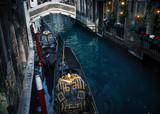 Two docked gondolas in Venice canal, Italy