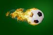 canvas print picture - Fliegender brennender Fußball vor grünem Hintergrund