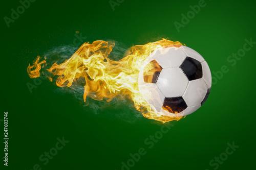canvas print picture Fliegender brennender Fußball vor grünem Hintergrund