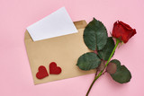 Love letter. Note paper with envelope, red rose and decorative hearts