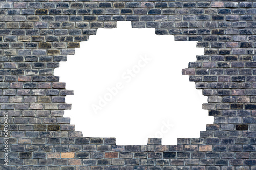 An old wall of old blackened bricks with a break in the center of the isolated with white - 247604320
