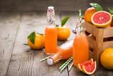 Fresh grapefruit juice in the bottle