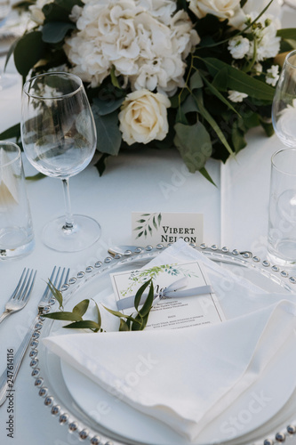 Leinwandbild Motiv Classic white set of wedding dinner table. White bouquets as a centerpiece